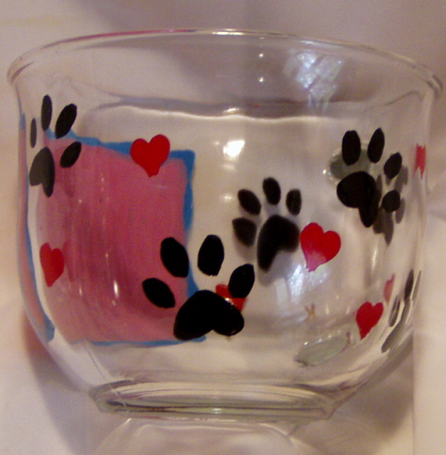 """Love My Dog""- 14 oz.  glass mug. Painted label with standard blue or pink (or choose your favorite color!) background, ""Love My Dog"" written in script and in braille. Mugs have paw prints and red hearts around the rest of the mug."